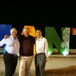 Ariosto Andrade, Carlos Castro Pat and Craig Carothers in front of Manta Sign