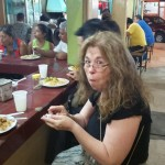 Pam eating at counter in Central Market